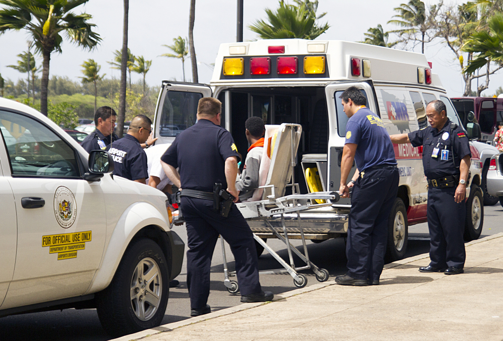 A 16-year-old boy who stowed away in the wheel well of a flight from San Jose, Calif., to Maui is loaded into an ambulance at Kahului Airport in Kahului, Maui, on Sunday afternoon.