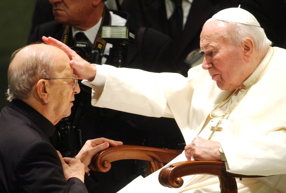 Pope John Paul II gives his blessing to late priest Marcial Maciel in 2004. The Vatican suspended Maciel for two years to kick a morphine habit but, according to documents, overlooked other abuses and financial improprieties.