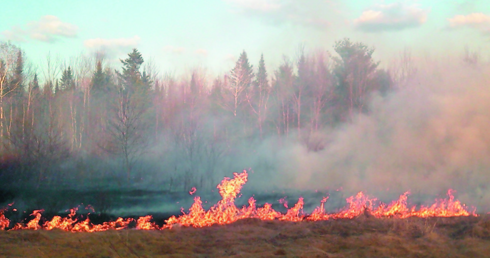 A Clinton wildfire shown in this April 2012 photo burned about 6 acres of grass and brush before it was contained.