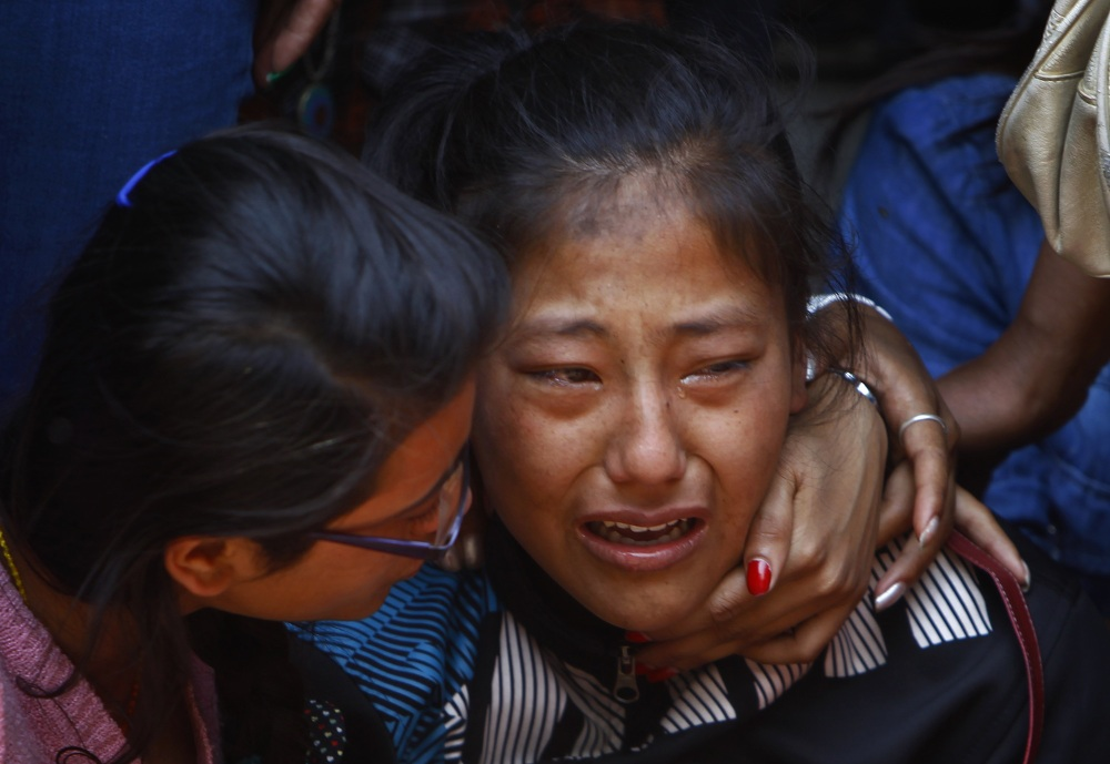 A relative of one of the Nepalese climbers killed in an avalanche on Mount Everest cries during the funeral ceremony in Katmandu, Nepal, Monday. The avalanche killed at least 13 Sherpas. Three other Sherpas remain missing and are presumed dead.