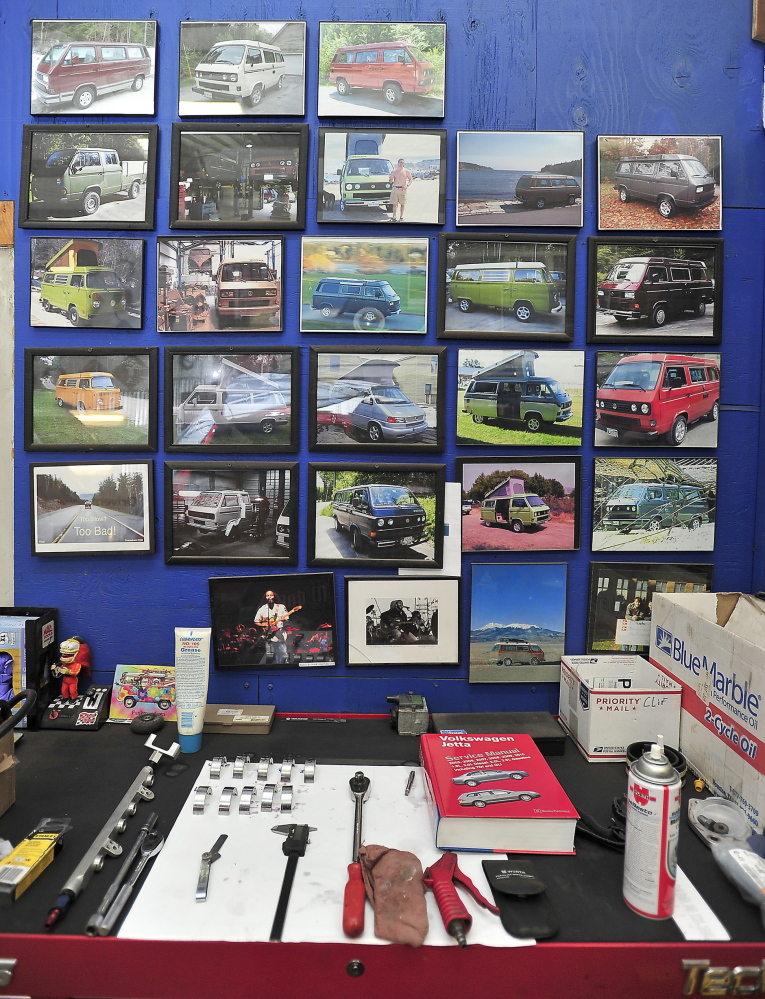 Photos of completed projects line the wall behind a work bench at Foreign Auto & Supply Inc. in Harpswell. Services can cost tens of thousands of dollars, depending on the scope of the project.
