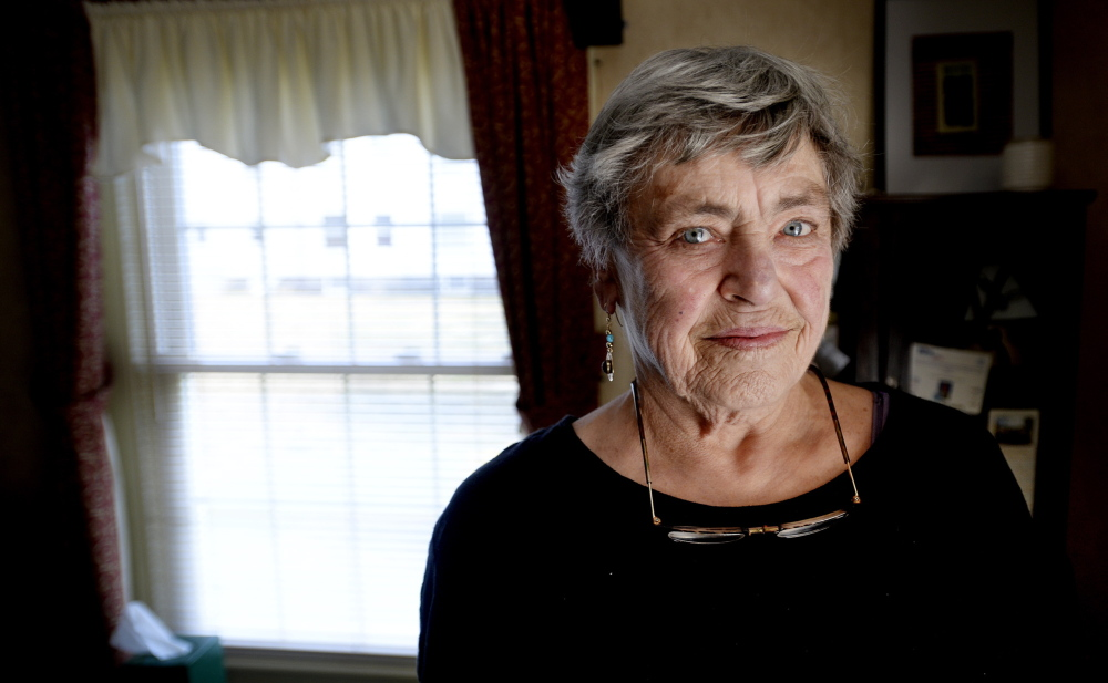 Retired nurse Nancy Johnson of Cape Elizabeth, seen in her home Thursday, expected a refund after filing her 2013 federal tax return on April 9. But it was rejected because someone had already filed a return using her Social Security number.