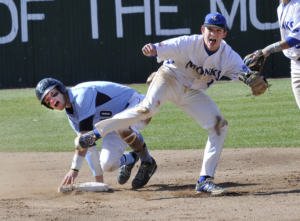 Max McCoomb of St. Joseph's reacts Thursday after forcing Dan Gagnon of Lasell at second base and throwing to first to complete a double play at Standish. The Monks won 9-2 and will be home against top-seeded Suffolk at 1:30 p.m. Saturday in the GNAC tournament.