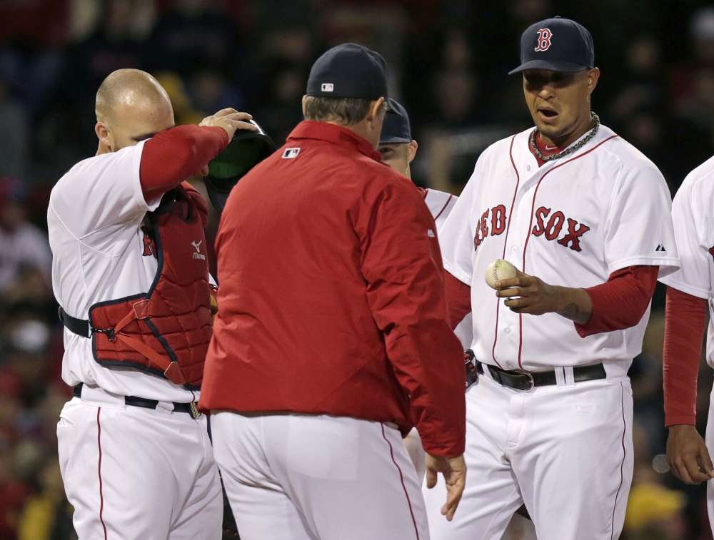 Boston Red Sox starting pitcher Felix Doubront, right, hands the ball to manager John Farrell as he is taken out while trailing the New York Yankees in the third inning Thursday in Boston. Red Sox catcher David Ross is at left.