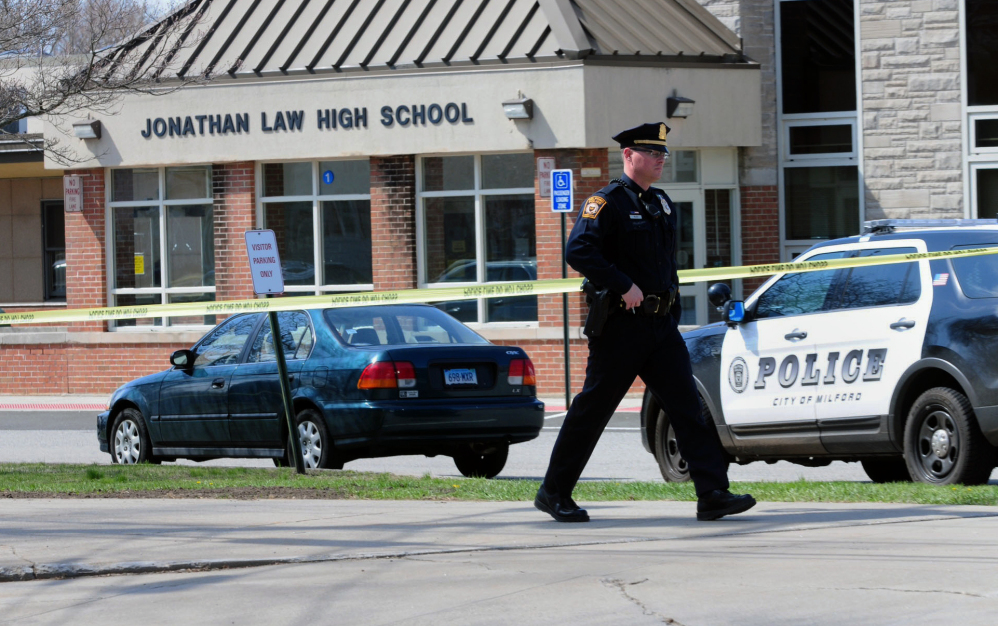 Police remain on scene at Jonathan Law High School after a 16-year-old girl was stabbed to death in Milford, Conn., on Friday.