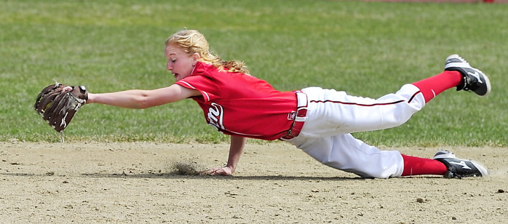 Scarborough second baseman Ashley Gleason dives to snag a hard grounder Friday during the 13-4 victory against visiting South Portland. Gleason also went 3 for 4 while batting in the No. 8 spot in the lineup.