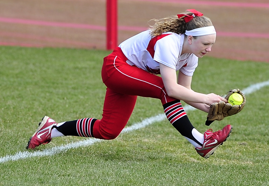South Portland right fielder Madison Houlette keeps her balance and her poise to come up with a tough catch of a pop fly in foul ground.