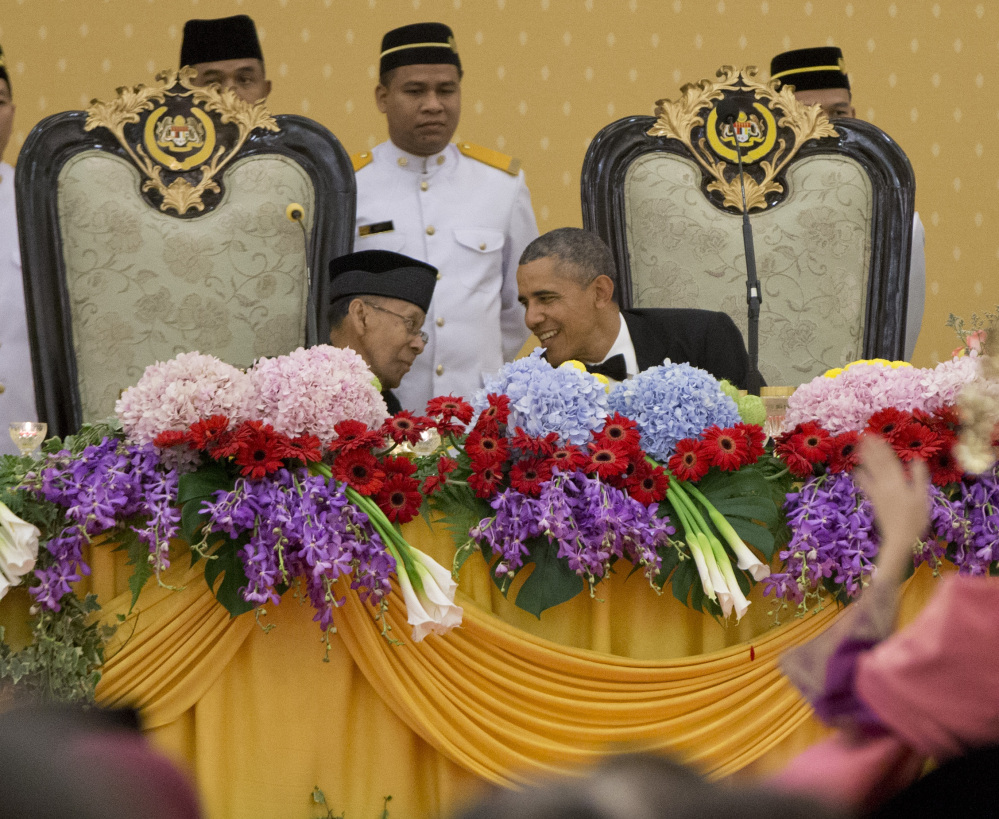 President Obama, right, talks with Malaysian King Abdul Halim Mu'adzam Shah during a state dinner at the King's Palace or Istana Negara in, Kuala Lumpur, Malaysia, on Saturday. The last U.S. president to visit Malaysia was Lyndon B. Johnson in 1966.
