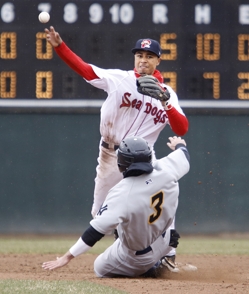 Second baseman Mookie Betts makes the pivot and fires to first to complete a double play after forcing Taylor Dugas of the Trenton Thunder in the eighth inning.