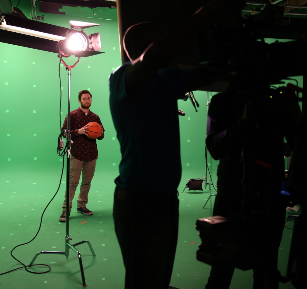 A video team preps for a shoot at Onion Labs, built in 2012 to create custom commercials reflecting The Onion's comedic sensibility.