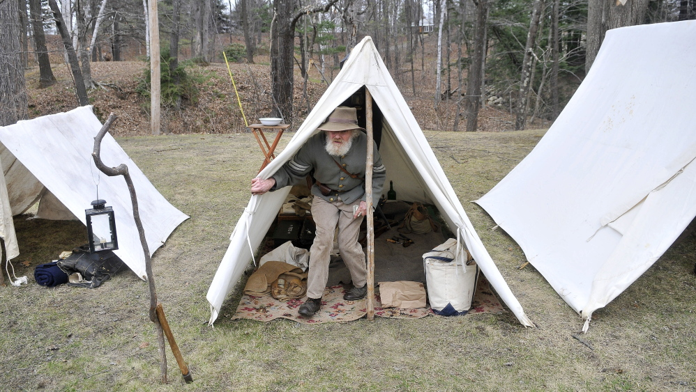 Tom Basford of Gardiner, acting as a corporal with the Confederate Army's 15th Alabama, Company G, emerges from his tent Saturday at a Civil War camp at Abbott Park in Farmington.