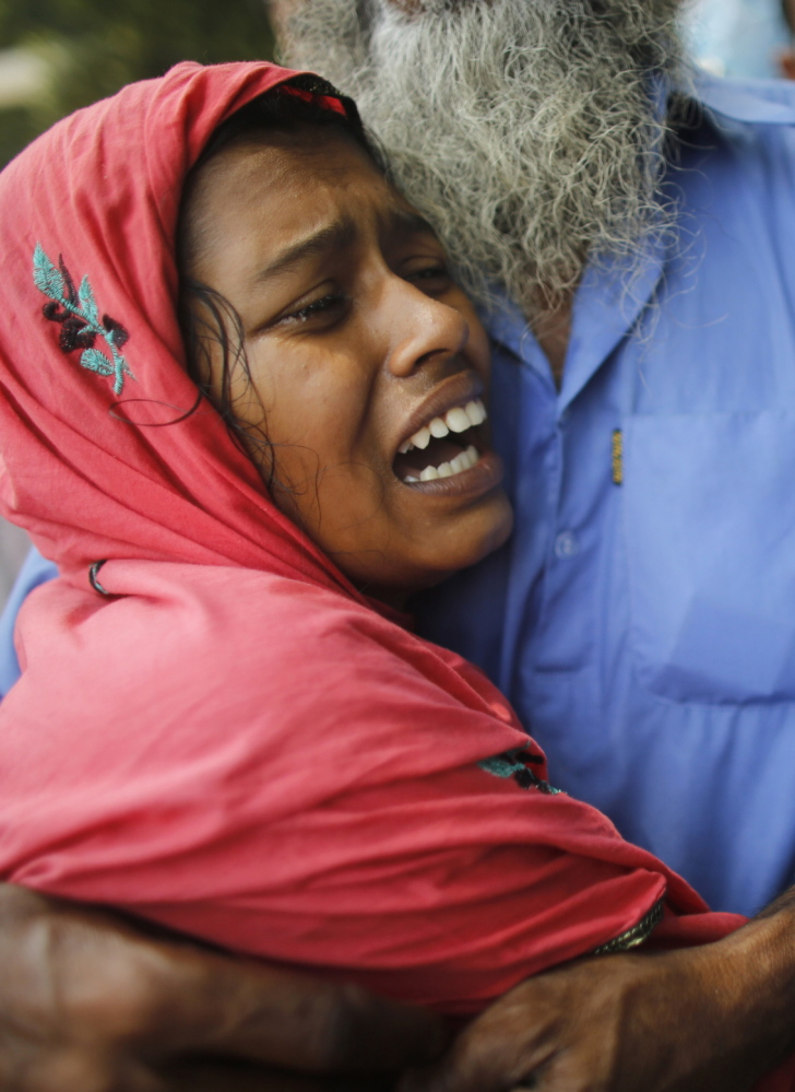 A woman mourns her husband, who died in the collapse of the Rana Plaza factory in Bangladesh last year. The injured and family members of those killed are still waiting for compensation.
