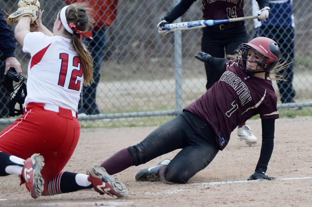 Thornton Academy's Brooke Cross slides safely into home as South Portland pitcher Olivia Indorf fields the catcher's throw after a wild pitch during a 4-3 softball win by South Portland on Monday.