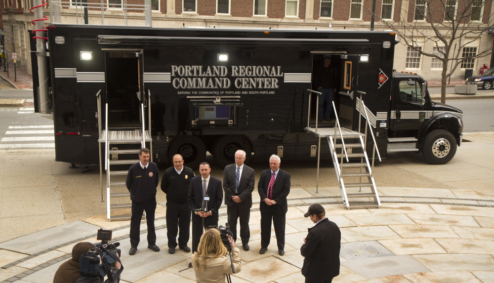 Portland and South Portland officials take questions at City Hall plaza in Portland Monday while discussing the benefits of a new Regional Command Vehicle for the two cities. The vehicle cost about $400,900 and has another $60,000 in radio and computer gear.