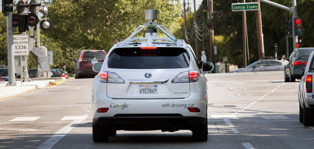 A photo provided by Google shows the company's self-driving car navigating along a street in Mountain View, Calif., last week. The director of Google's self-driving car project wrote in a blog post Monday that development of the technology has entered a new stage: trying to master driving on city streets.