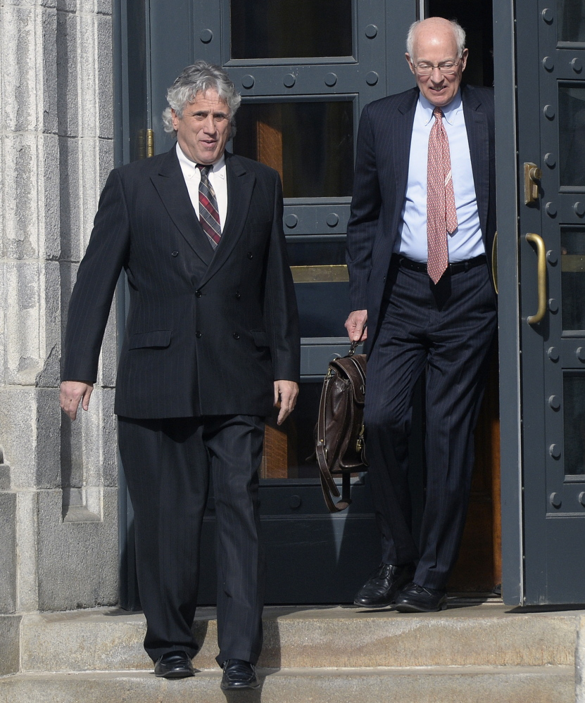 Maine attorney Gary Prolman, left, leaves U.S. District Court in Portland with his attorney, Peter DeTroy, on Tuesday, after Prolman pleaded guilty to a federal charge of money laundering.
