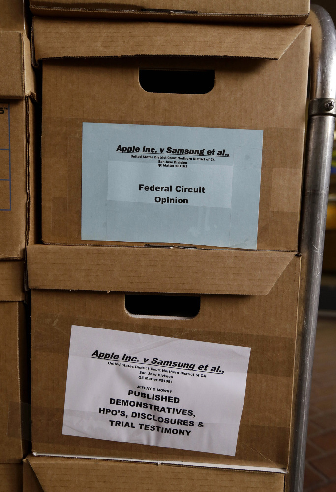 Boxes containing documents related to the Apple Inc. v. Samsung patent infringement case are stacked outside of a federal courthouse in San Jose, Calif., on Monday.