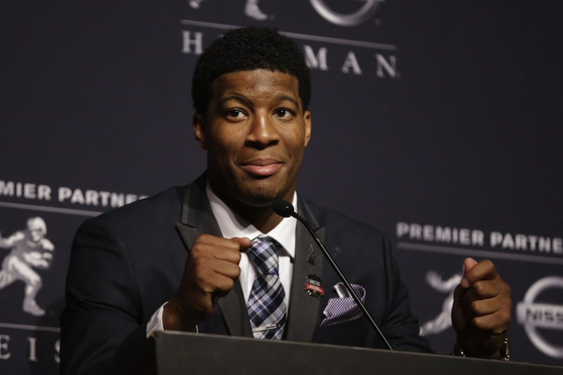 In this December 2013 file photo, Florida State quarterback Jameis Winston talks to reporters after winning the Heisman Trophy.