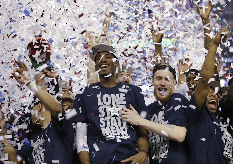 Connecticut forward DeAndre Daniels, and guard Niels Giffey celebrate after their team beat Kentucky 60-54 at the NCAA Final Four tournament college basketball championship game Monday in Arlington, Texas.