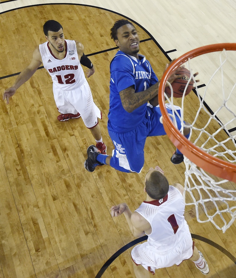 In this April 5 photo, Kentucky guard James Young, center, drives to the basket between Wisconsin guard Traevon Jackson, left, and guard Ben Brust, right, during the first half of an NCAA Final Four tournament game. Young has declared for the NBA Draft. March Madness