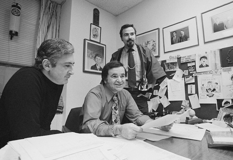 In this 1972 file photo, Mad magazine editor Al Feldstein, center, sits with art director John Putnam, left, and a freelancer named Jack, at the magazine's New York headquarters.