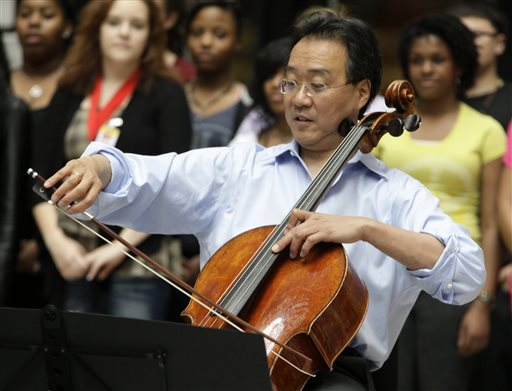 World-famous cellist Yo-Yo Ma plays in the rotunda of the State of Illinois building in Chicago. He will receive the first Fred Rogers Legacy Award next month.