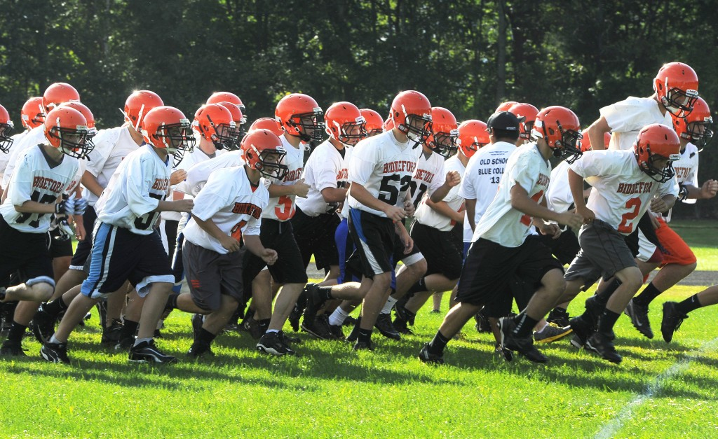 Sprints are part of the first day of football practice at Biddeford HS with coach Brian Curit. John Patriquin/Staff Photographer