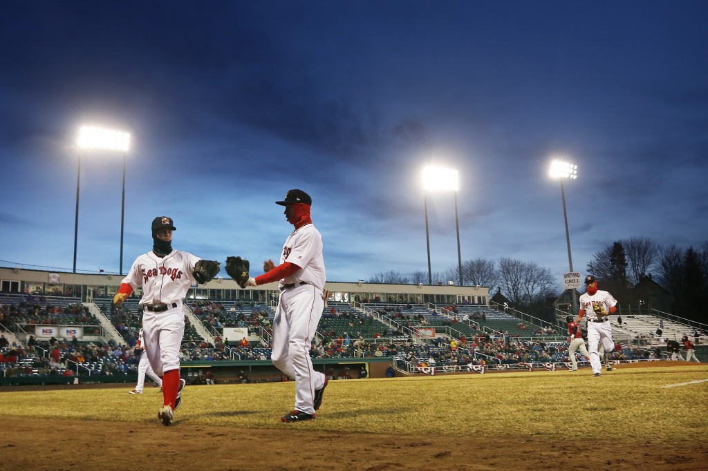 Sean Coyle, left, and Mookie Betts of Portland slap hands as they come off the field, Thursday, April 10, 2014, after the top of the 5th inning on opening day at Hadlock Field. Derek Davis/Staff Photographer