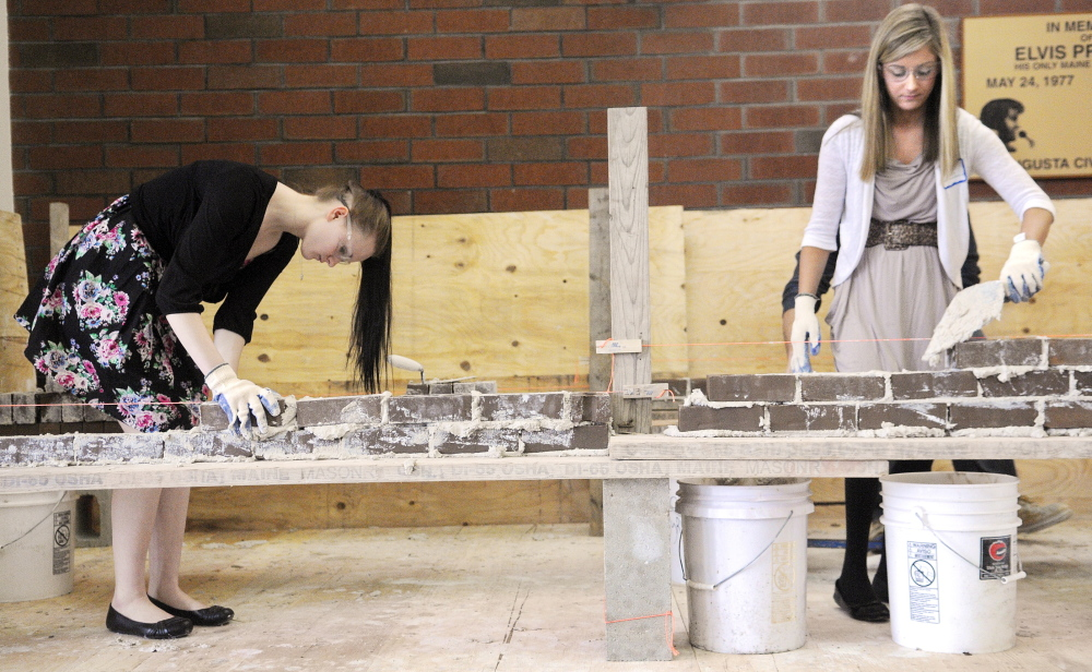 Waterville Senior High School senior Destiny Petit, left, and Madison Area Memorial High School junior Gretchen Miller assemble a brick wall Wednesday during the annual Jobs for Maine's Graduates Career Development Conference in Augusta.