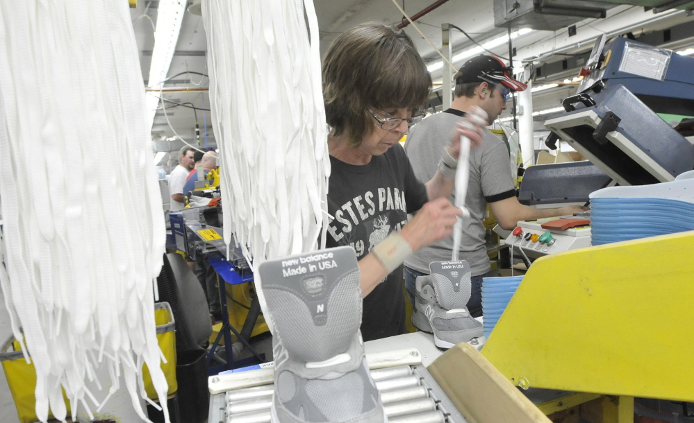 Sharon Estes inserts laces into shoes at New Balance's Norridgewock factory in 2011. The U.S. military – which, for years, has flouted a law requiring the Pentagon to favor some American-made products – recently announced it will direct recruits to buy only American-made sneakers.