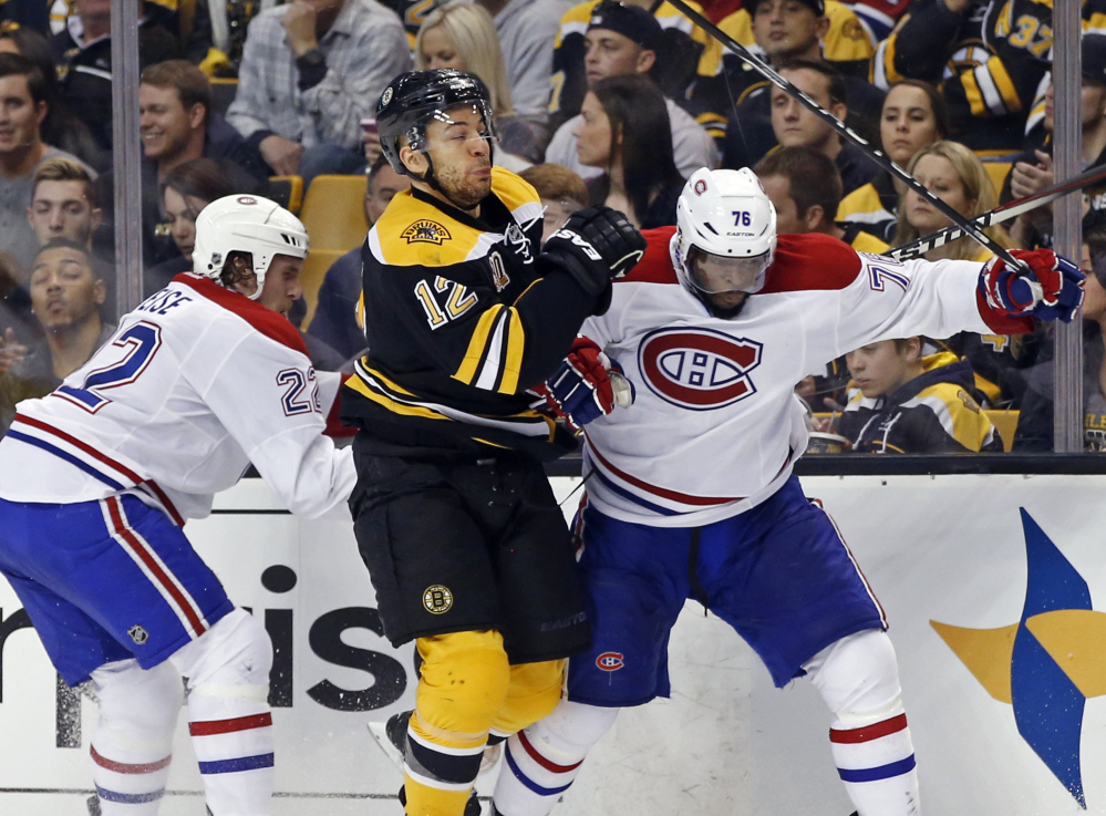 Boston Bruins right wing Jarome Iginla, center, grapples along the boards with Montreal Canadiens right wing Dale Weise and defenseman P.K. Subban on Thursday in Boston.