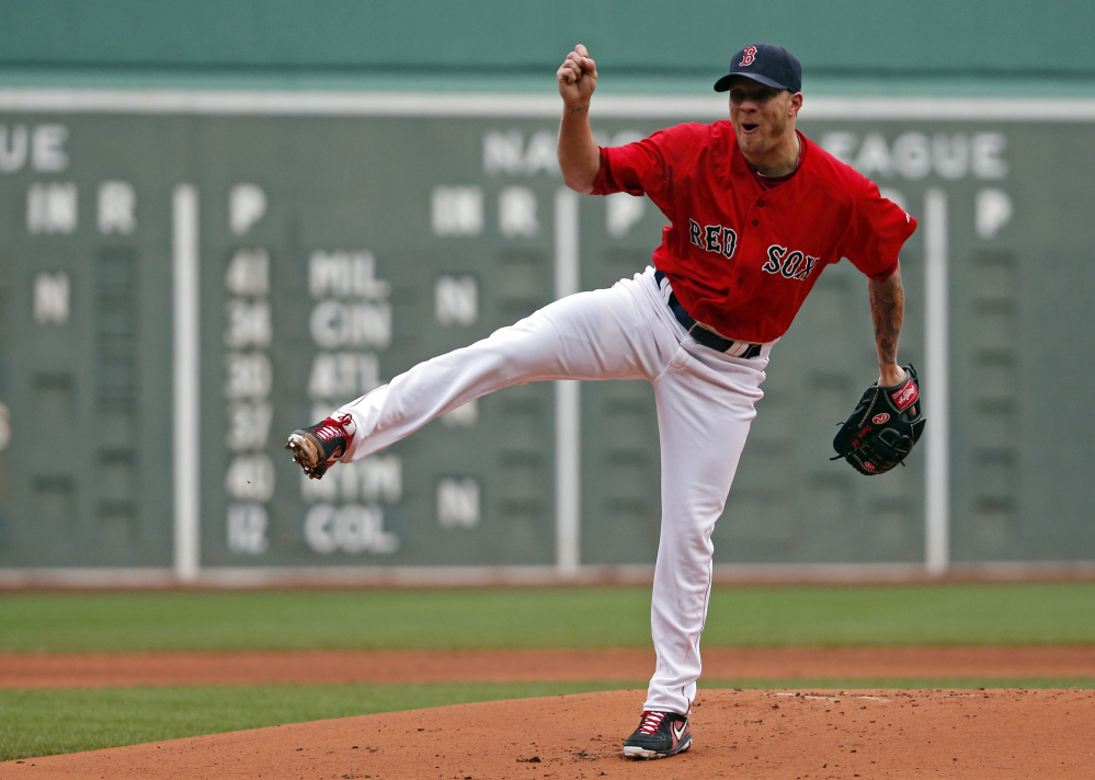 Boston Red Sox starting pitcher Jake Peavy delivers to the Tampa Bay Rays in the first inning in the first game of a doubleheader at Fenway Park on Thursday.