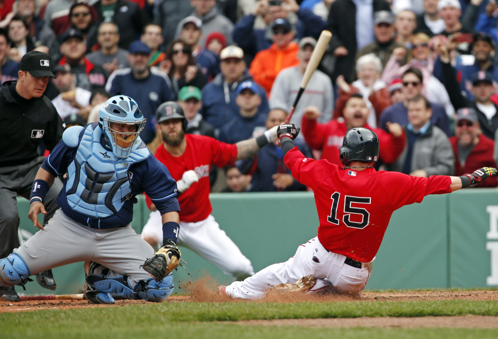 Tampa Bay Rays catcher Jose Molina moves to tag out Red Sox second baseman Dustin Pedroia who was trying to score on a double by David Ortiz in the seventh inning in the first game of a doubleheader at Fenway Park on Thursday.