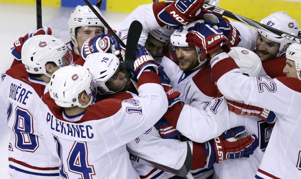 Canadiens defenseman P.K. Subban (76) is surrounded by teammates after scoring the game-winning goal off Boston Bruins goalie Tuukka Rask during the second overtime period of Game 1 Thursday. The Canadiens won 4-3.