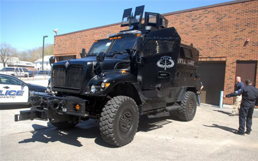 Willimantic, Conn.'s war-tested Mine Resistant Ambush Protected vehicle is parked outside the village's Police Department. The MRAP was given to the town by the U.S. military and will be used by the department's SWAT team to deploy officers safely, rescue officers and residents, and negotiate in barricade situations.