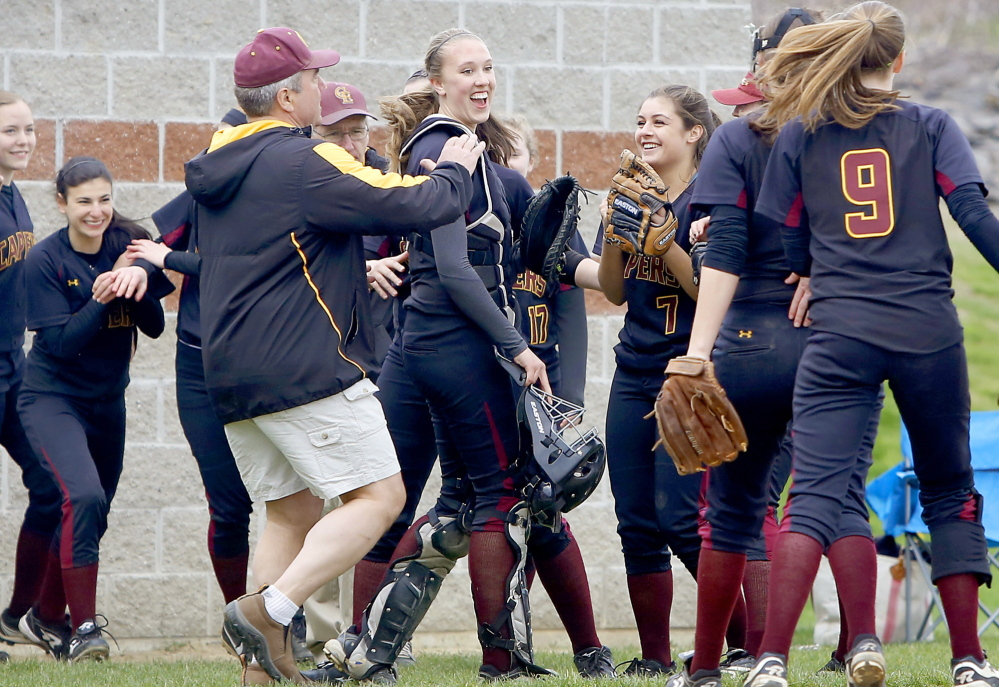 Cape Elizabeth players and coaches celebrate after the Capers ended a Fryeburg Academy threat with a good defensive play during their 5-1 victory Saturday in a Western Maine Conference softball game at Cape Elizabeth.