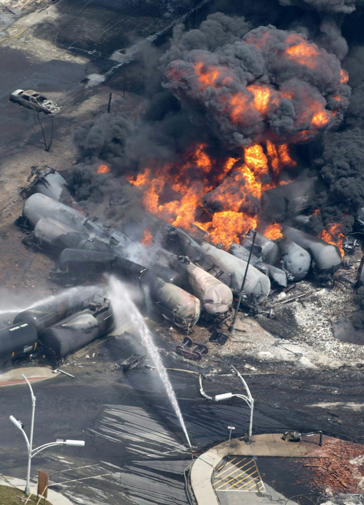 Smoke rises after railway cars carrying crude oil derailed in Lac-Megantic, Quebec, on July 6, killing 47 people.