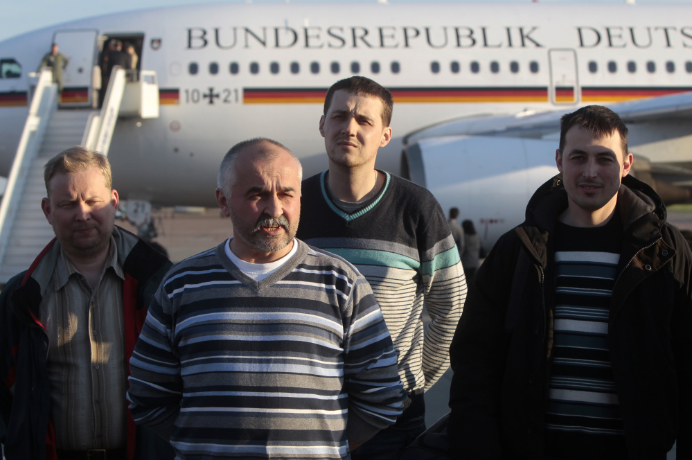 Some of the OSCE monitors who were released by Ukrainian insurgents Saturday take part in a briefing at Boryspil airport outside Kiev. The pro-Russia insurgent leader in Slovyansk was quoted as saying he ordered the release because of increasing insecurity in the city.