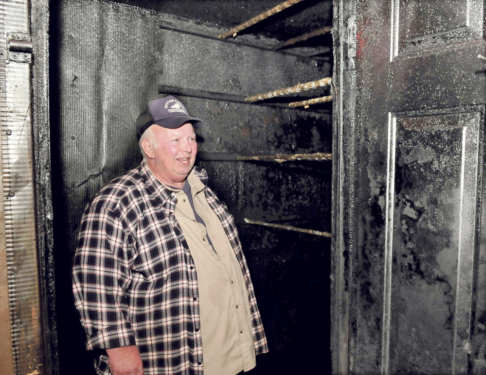 Dave Dutton stands inside a smoke room at his home in Vassalboro where he smokes alewives and other kinds of meats. He plans to enter an alewife chowder cook-off during the Benton Alewife Festival in May.