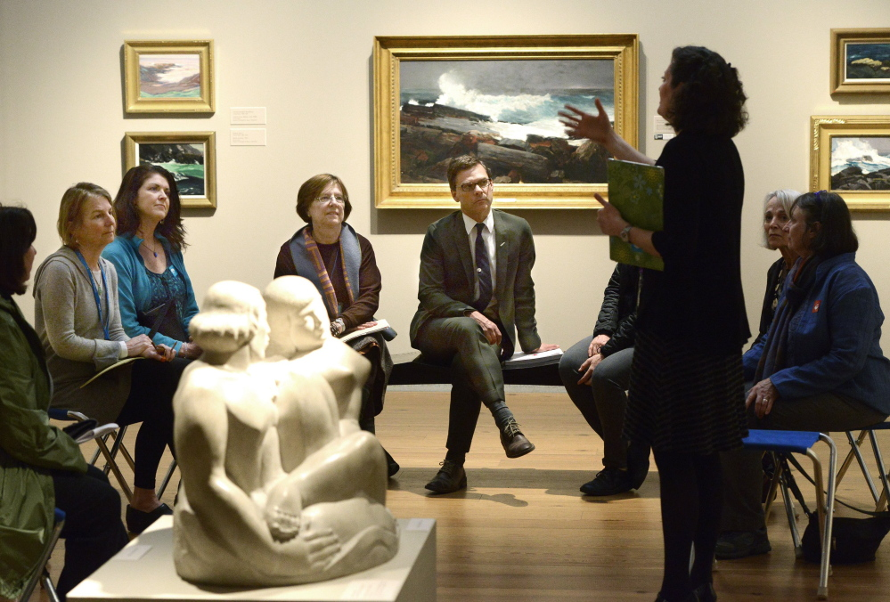Portland Museum of Art director Mark Bessire, center, takes part in a tour at the museum with Stacy Rodenberger, standing, and other members of the Learning and Interpretation Committee last month. One member of the museum's board says Bessire's greatest accomplishment has been his able stewardship of the cultural institution during challenging times.