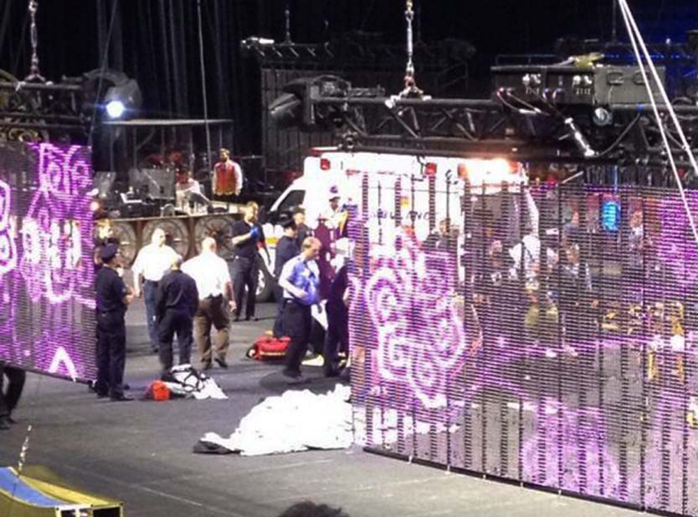 In a cell phone photo provided by Tara Griggs, emergency workers tend to injured performers after a platform collapsed on Sunday during the Ringling Brothers and Barnum and Bailey Circus' Legends show at the Dunkin' Donuts Center in Providence, R.I. At least nine people were injured in the fall, including a dancer below.