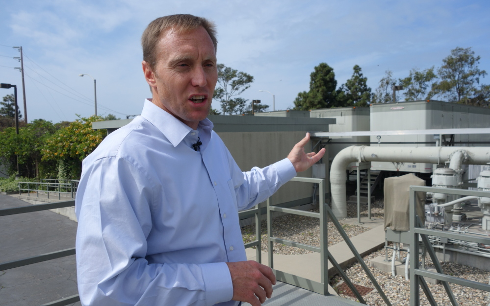 Joshua Haggmark, interim water resources manager for Santa Barbara, Calif., stands next to a desalination plant that has been in storage for more than two decades. The city is considering restarting the plant as California withers in a drought.