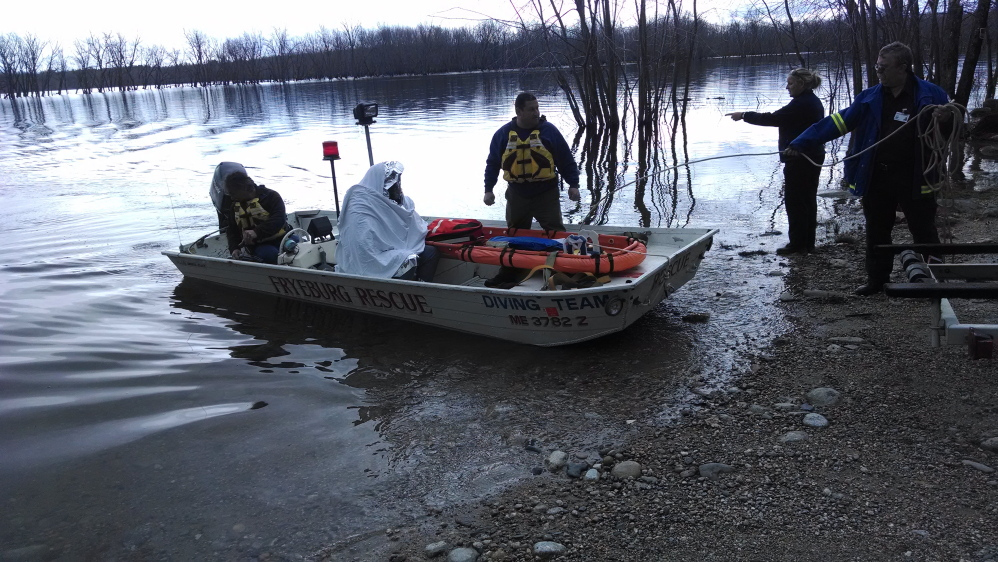 A Fryeburg rescue crew bring in a man from the Saco River after his canoe capsized in a hailstorm.