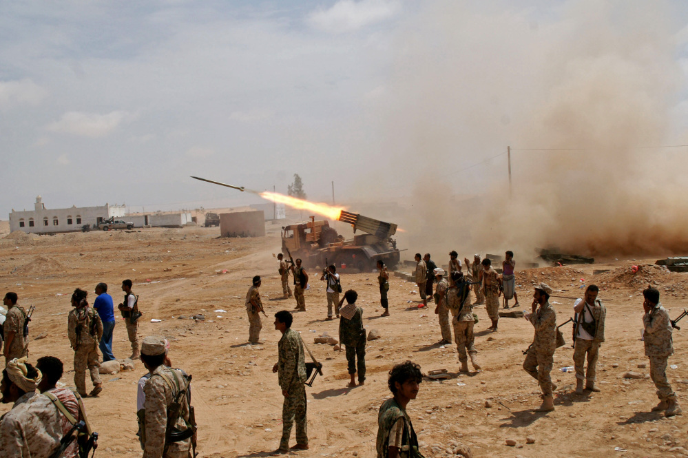 Yemeni army soldiers fire rockets at mountainous positions of al-Qaida militants at the town of Meyfaa, in the southern province of Shabwa, Yemen, on Sunday. Heavy clashes and airstrikes left six suspected al-Qaida militants and many soldiers dead in Yemen's southern Shabwa province in an ongoing military campaign.