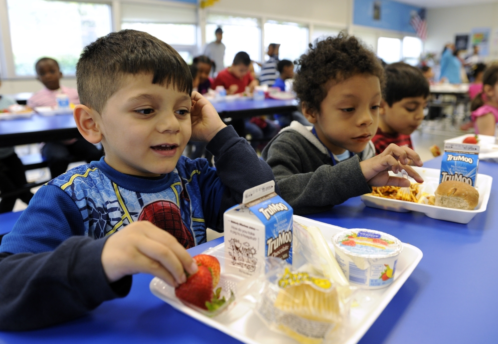 Biden Arias-Romers, 5, left, and Nathaniel Cossio-Boatwright, 6, eat lunch at the Patrick Henry Elementary School in Alexandria, Va. Starting next school year, pasta and other grain products in schools will have to be over half whole grain.