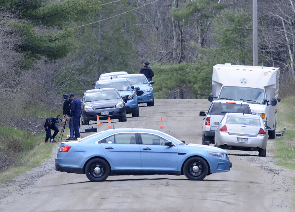 Maine State Police search a site in Richmond on Monday while investigating the death of a Gardiner man whose remains were found at the site, according to police.