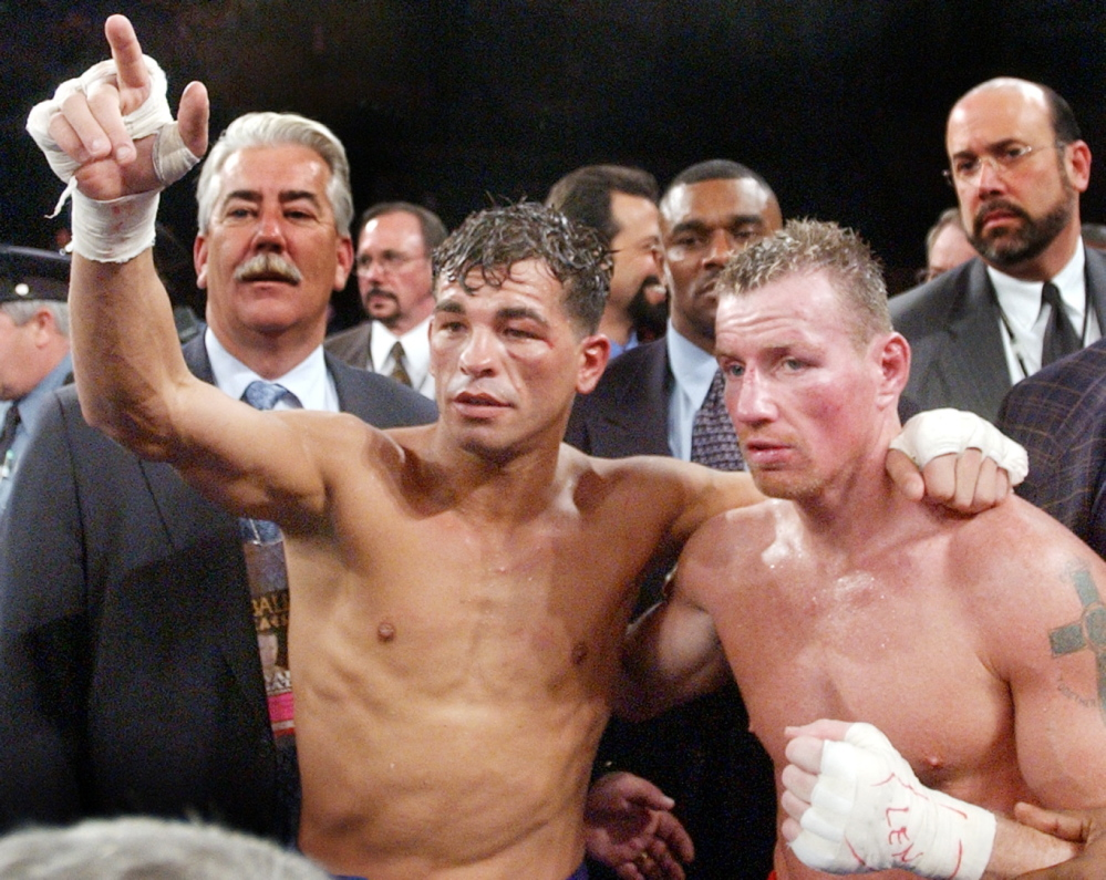 Arturo Gatti, left, and Micky Ward, fought three times, twice in 2002. The two pose after the second 2002 fight, won by Gatti by unanimous decision.