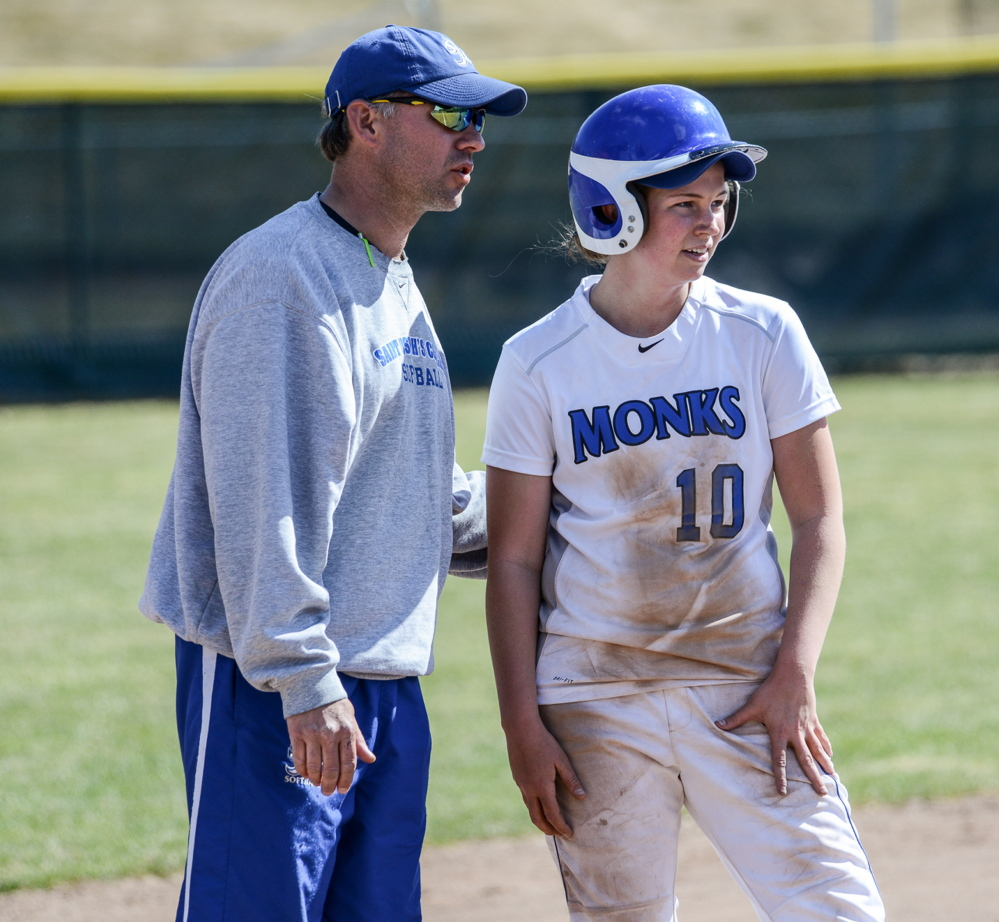 St. Joseph's Coach Jamie Smyth offers advice to Danica Gleason, who is hitting .459 with 24 runs scored and 22 RBI as the Monks head to the NCAA Division III tournament.