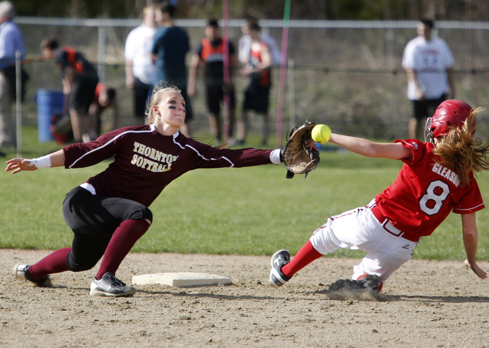 Ashley Gleason of Scarborough just beats the throw to Thornton's Brooke Cross as Gleason earns a fifth-inning steal of second base during the Red Storm's 5-1 win at Saco on Monday.