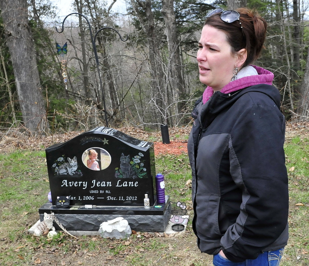 Tabitha Souzer, Avery Lane's mother, speaks at her daughter's grave at the Friend's Cemetery in Fairfield on Tuesday. Souzer said the grave has been vandalized three times.